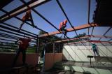 Image gallery of Haiyan survivors rebuild a year after typhoon nightmare.