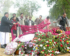 Father Emmanuel Yousaf Mani lays a floral tribute on Salman Taseer's grave in Lahore