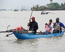 People being rescued in small boats