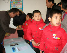 Fufeng county government officials visit children at the Xinyue Center for Special Education in Yingxi