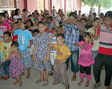 Children from St. Joseph's parish in Yangon perform songs at the monthly gathering