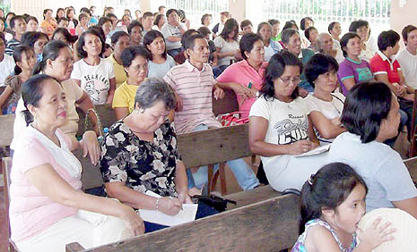Villagers gather for their weekly faith session