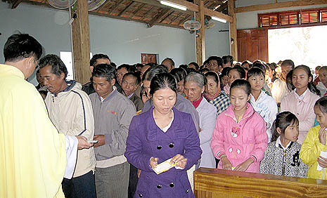 People receiving colorful papers containing verses of the Scripture