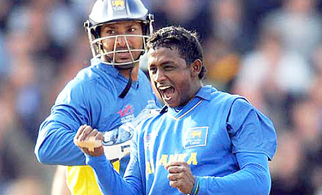 Ajantha Mendis (right) celebrates after taking a wicket during a match