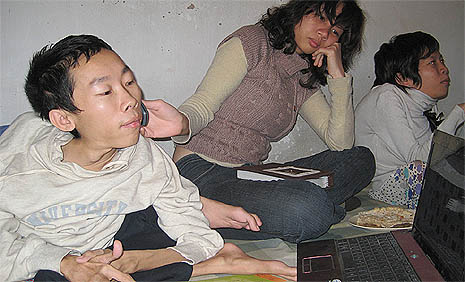 Francis Xavier Nguyen Cong Hung, Knight of IT, (left) working on a computer