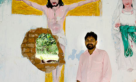 Father Ajay Kumar Singh in a church in the Kandhamal area of Orissa, destroyed in the 2008 violence Photograph ©Michael Coyne