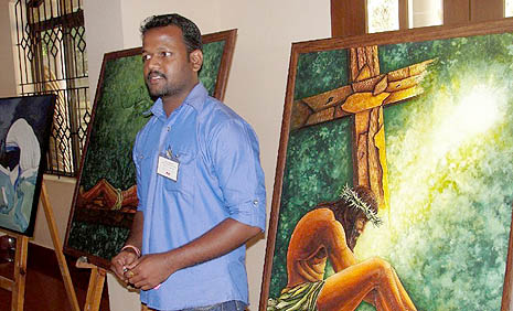 Jeevan A.S. a Hindu artist with his paintings