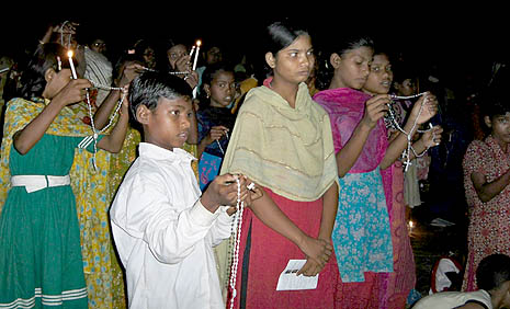Children in rural Bangladesh gather for praying of rosary