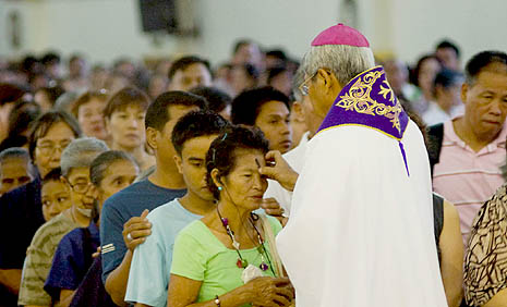 Catholics in the  Philippines receive the sign of the cross with ashes during an Ash Wednesday Mass (file photo)
