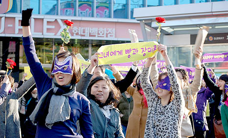 Women dancing on the street in Seoul celebrating International Women's Day