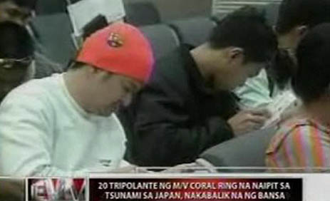 Filipino workers on their way home from Japan (GMA News TV photo)