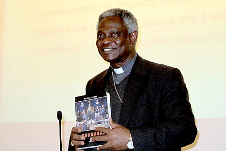 Cardinal Peter Turkson holds the Chinese edition of the Compendium of the Social Doctrine of the Church