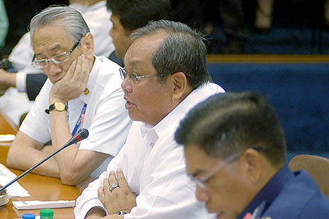 Retired Archbishop Oscar Cruz listens during a Senate inquiry into the numbers racket 'jueteng'