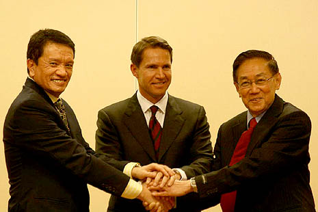 Peace negotiators  mark the start of formal talks with a handshake in Oslo last February