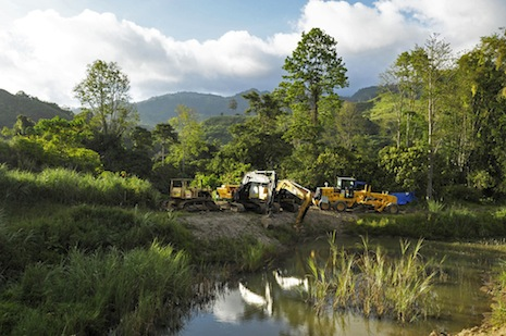 Heavy earthmoving equipment on site at the Tampakan project site <i> Photograph ©Michael Coyne</i>