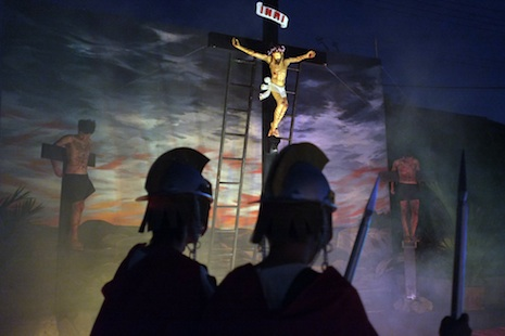 The crucifixion is re-enacted at Santa Cruz church in Bangkok using a statue of Christ but in the Philippines there is no shortage of volunteers for the role<i> Photograph ©Michael Coyne</i>