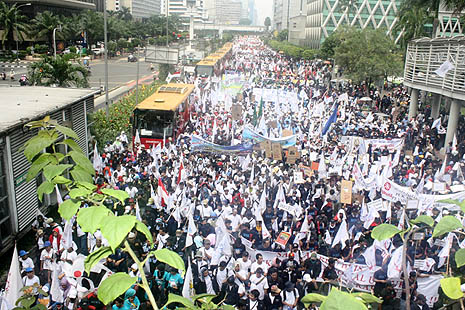 More than 5,000 workers marched through streets in Jakarta yesterday