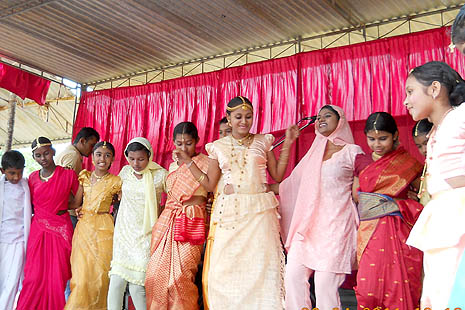 Children performing a cultural dance on inter ethical unity
