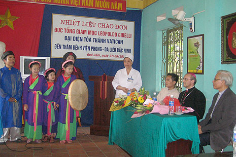 Children of lepers giving cultural performance to visiting Archbishop Leopoldo Girelli (second from right) at a state-run leprosarium on June 7