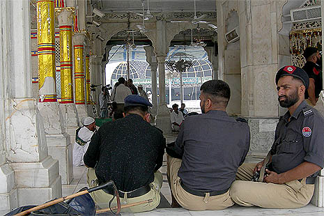 Police guarding a mosque in Karachi