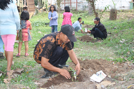 Parishioners plant agarwood saplings in the seminary's garden