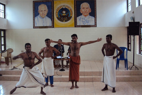 Classical dancers performing the work