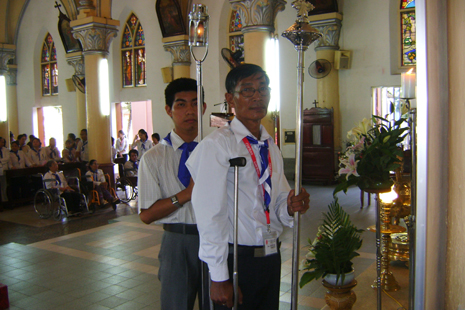 Peter Nguyen Thach at a special Mass held for parishioners with physical disabilities