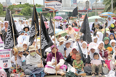 Children with their mothers at a fuel price protest today in Jakarta