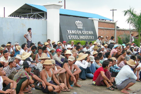Striking factory workers in front of Yangon Crown Steel company in Hmawbi township, Yangon Division