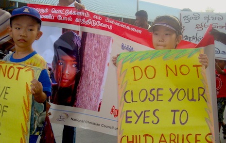 Activists and children protest child abuse in Colombo