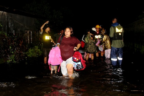 Residents in Zambales province leave their flooded homes (Photo by Anthony Bayarong)