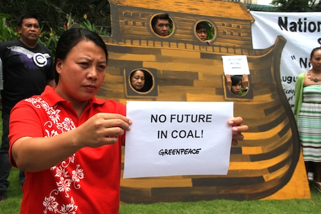 Josephine Pareja shows her opposition to the building of a coal plant in her community (Photo by Joe Torres)