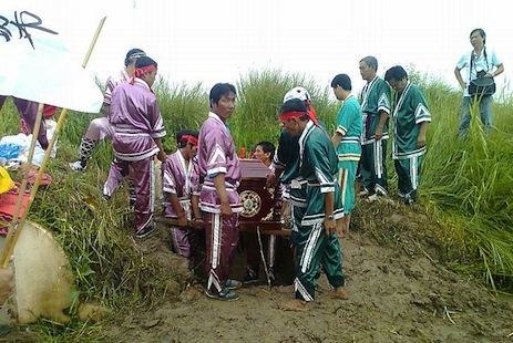 Dang Thi Kim Lieng's coffin is carried to her grave