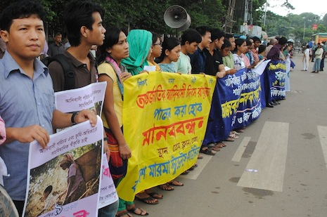 Indigenous minorities form a chain during protests in Dhaka