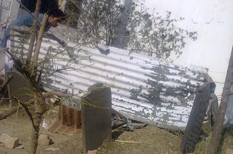 The metal perimeter wall of the shrine was blown several meters away