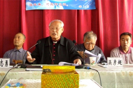 Bishop Li (center) at a meeting in 2011