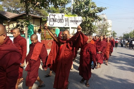 Buddhist monks march in protest on Wednesday in Mandalay