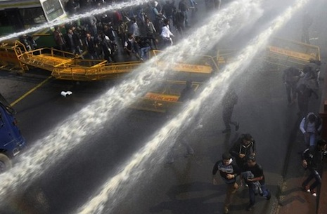 Police use teargas, water to disperse rape protesters