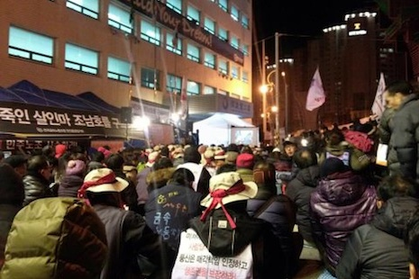 Workers rally at the offices of Harbin Heavy Industries after one of their union activists killed himself