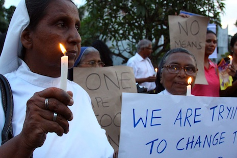 Women attend the vigil in Colombo