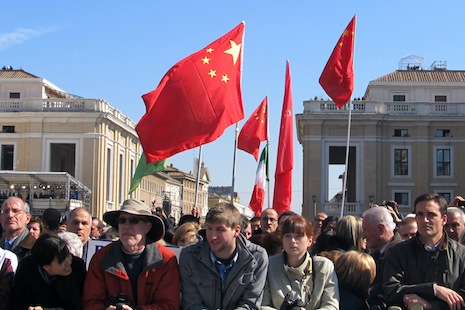 China flags were seen among the well wishers on the pope's farewell tour of St Peter's Square