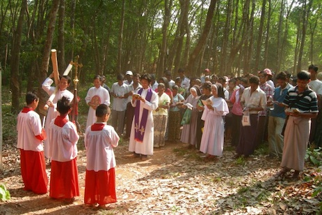 Pilgrims take part in a Way of the Cross at the foot of the  mountain