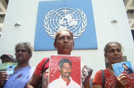 Relatives of people killed or who went missing in the closing stages of the civil war protest outside the UN office