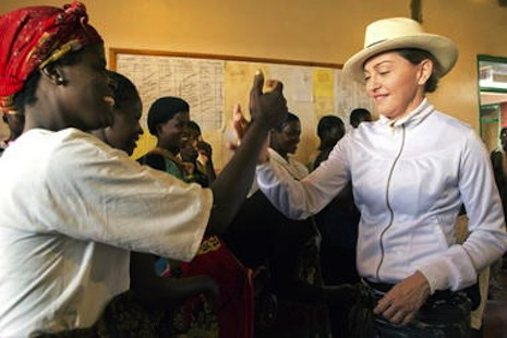 Madonna meets orphanage volunteers; two of her adoptive children are from Malawi