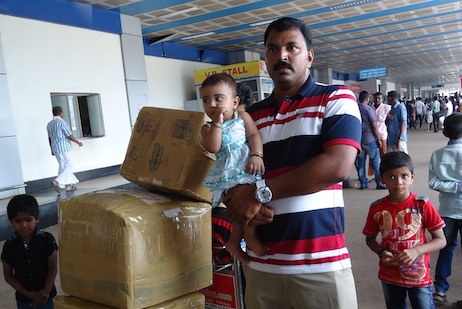 A Kerala migrant arrives home from Saudi Arabia
