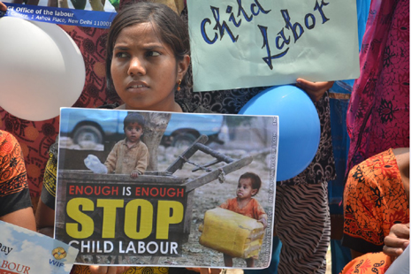 <p>Protestors hold placards during World Child Labor Day in New Delhi</p>