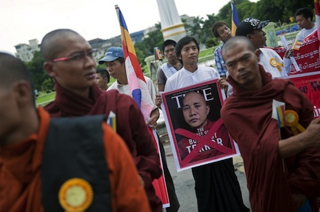 <p>Monks marched in protest last week, over a Time magazine article describing Wirathu as 'the face of Burmese terror' (picture: AFP/Ye Aung Thu)</p>