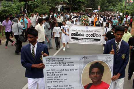<p>Protesters hold a placard of Akila Dinesh, the 17-year-old killed last week</p>