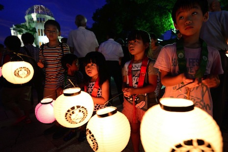 <p>Children with lanterns pray for the victims of the nuclear attack on Hiroshima during a vigil at the Peace Memorial Park on Monday (AFP photo/Toru Yamanaka)</p>