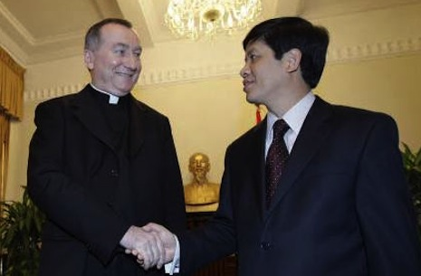 <p>Pietro Parolin, left, with Vietnam's Vice Foreign Minister Nguyen Quoc Cuong during an official visit in 2009</p>